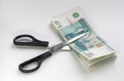 Scissors that cut banknotes Stock Photography