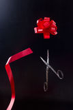 Scissors cut bow of tape Stock Photos