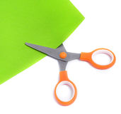Scissors cut colored paper. royalty free stock photos