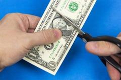 Scissors cut a dollar. stock photography