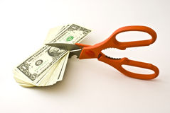 Scissors cut dollars Royalty Free Stock Photos