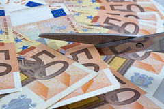 Scissors cut euro Stock Image