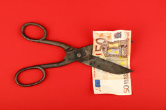Scissors cut Euro banknote over red background Stock Photography