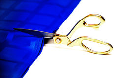 Scissors cut a fabric Royalty Free Stock Images