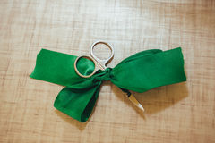 Scissors cut green silk ribbon Stock Images