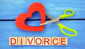 Scissors cut heart. the inscription `divorce`. the concept of breaking relations, quarrels. treachery, betrayal. cancellation of m Stock Photo