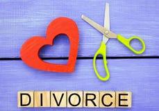 Scissors cut heart. the inscription `divorce`. the concept of breaking relations, quarrels. treachery, betrayal. cancellation of m Stock Photos