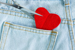 Scissors cut heart love on jeans Royalty Free Stock Image