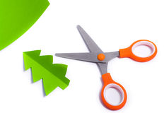 Scissors cut out fir of paper Stock Image