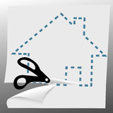 Scissors cut out a house symbol on dotted line Stock Photo
