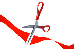 Scissors cut red ribbon in grand opening Royalty Free Stock Photos