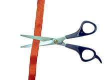 Scissors cut red tape Royalty Free Stock Photo