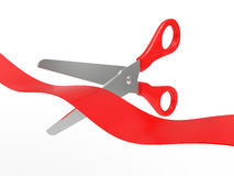 Scissors cut a red tape Stock Photography