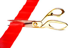 Scissors cut a red tape Royalty Free Stock Images