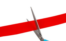Scissors cut ribbon. Isolated on white Stock Photography