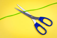Scissors cut rope. Royalty Free Stock Images