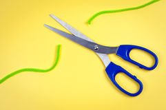 Scissors cut rope. Royalty Free Stock Image