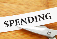 Scissors cut spending Stock Images
