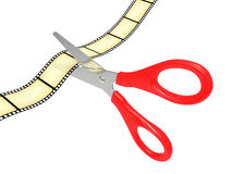 Scissors cut a tape a film Stock Photo