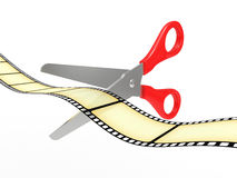 Scissors cut a tape a film Stock Image