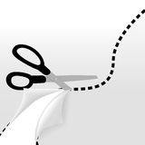 Scissors cut wavy dotted line on page Royalty Free Stock Image