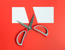 Scissors cut white paper Royalty Free Stock Image
