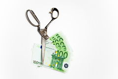Scissors cuts euro banknote on white. ScissScissors cuts euro banknote on white background Stock Images