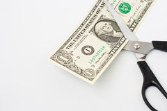 Scissors cuts one american dollar note Royalty Free Stock Images