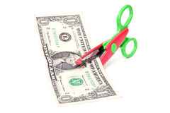 Scissors cuts one  dollar. Stock Photos