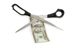 Scissors cutting a 100 dollars Royalty Free Stock Photos