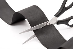 Scissors Cutting Black Ribbon Stock Photography