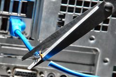 Scissors Cutting a Computer Ethernet Network Cable Royalty Free Stock Image