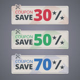 Scissors cutting coupons with discounts Stock Photo