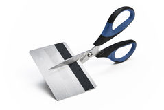 Scissors cutting credit card in halves Royalty Free Stock Images