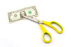 Scissors cutting dollar. Royalty Free Stock Images