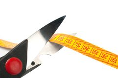 Scissors cutting a measuring Stock Image