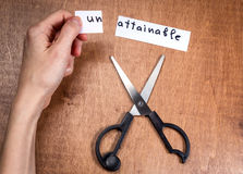 Scissors cutting negative label, self motivation concept Stock Image