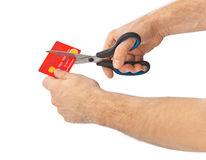Scissors cutting old credit card Royalty Free Stock Photo