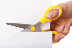 Scissors cutting paper Royalty Free Stock Photography