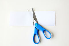 Scissors cutting a paper Royalty Free Stock Images