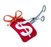 Scissors cutting a price tag for a new sale Royalty Free Stock Photos