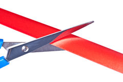 Scissors cutting red ribbon Stock Images