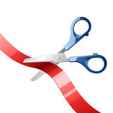Scissors cutting red ribbon Stock Image
