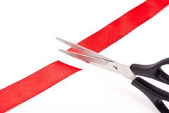 Scissors cutting red ribbon Stock Photo