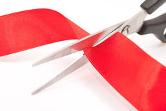 Scissors Cutting Red Ribbon Stock Photos