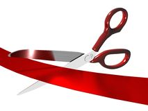 Scissors cutting a red ribbon. Red handled scissors cutting a red ribbon royalty free stock photography