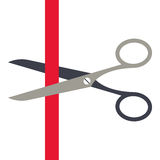 Scissors cutting a red ribbon Stock Photos