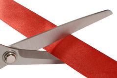 Scissors cutting red ribbon or tape, close up Stock Image