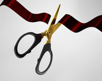 scissors cutting red ribbon on white background Royalty Free Stock Photos