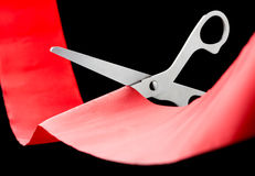 Scissors cutting ribbon Stock Photos